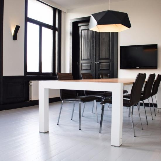 Meeting room with table and chairs black door
