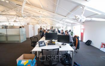 working desks in open shared space