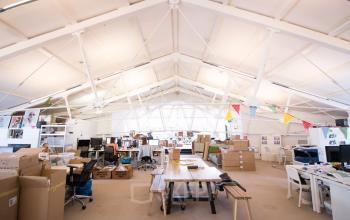 Many working places in bright open office space