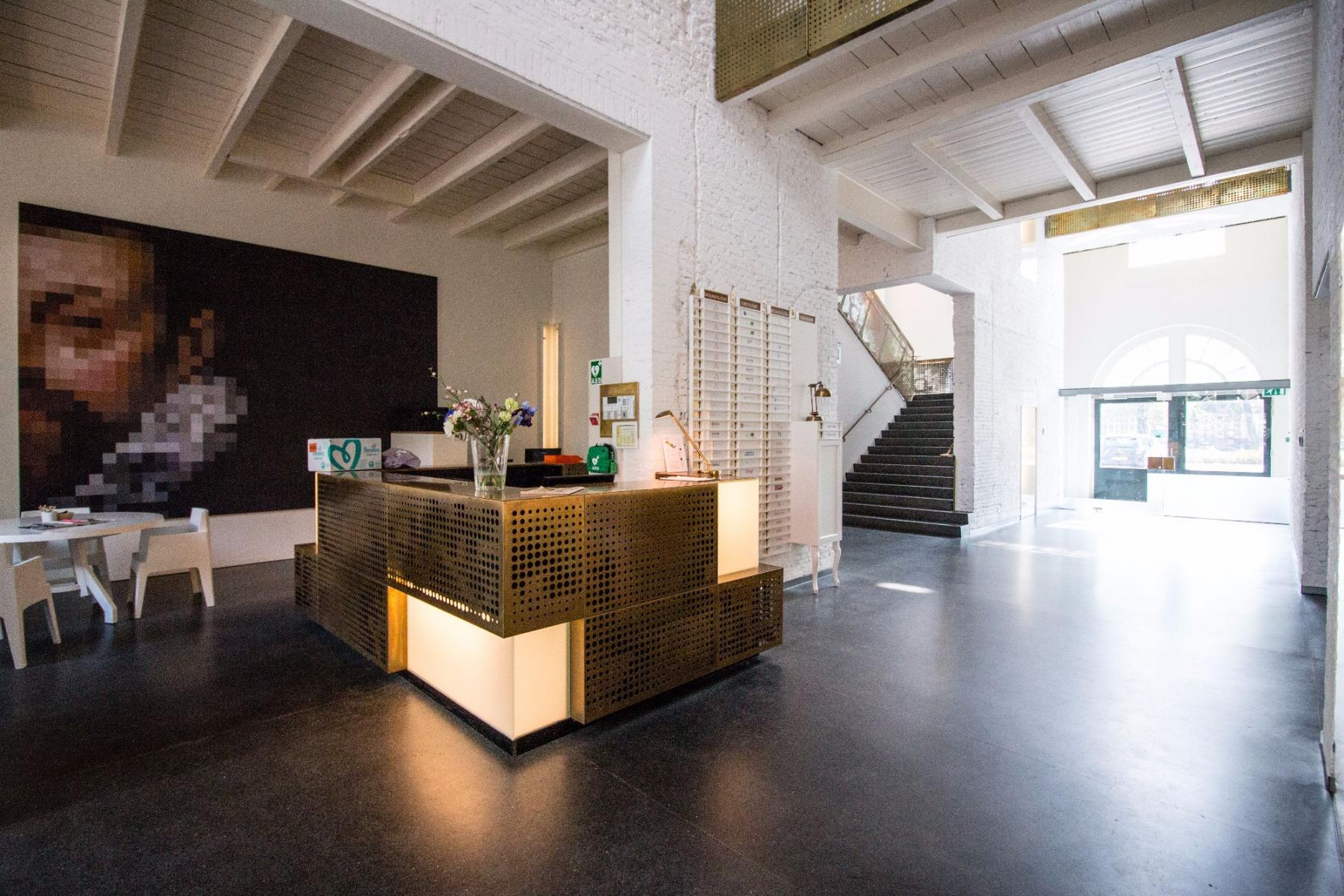 reception desk office building Amsterdam art painting