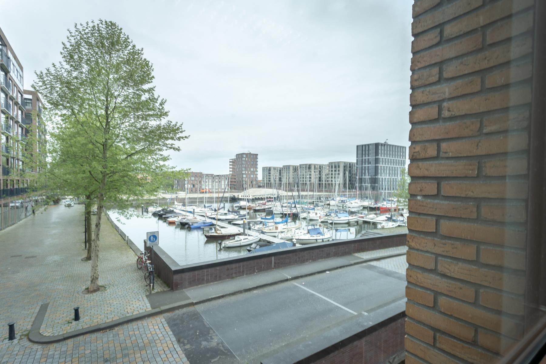 krijn taconiskade amsterdam ijburg zeeburg kantoorruimte kantoorkamers kantoorvleugel netjes bij de jachthaven
