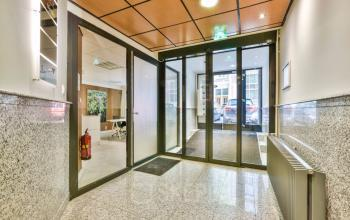entrance office building amsterdam glass doors