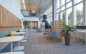 loungeruimte sociaalhart meubilair kantoorpand kantoorgebouw Zuidas