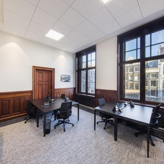 big office space for many people and big windows
