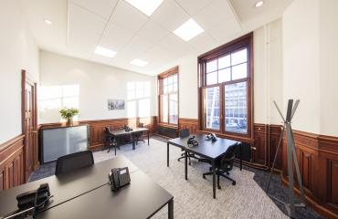 nice office room with big windows and nice black tables