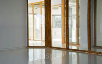 kantoorruimte kantoorkamer hout glas ramen