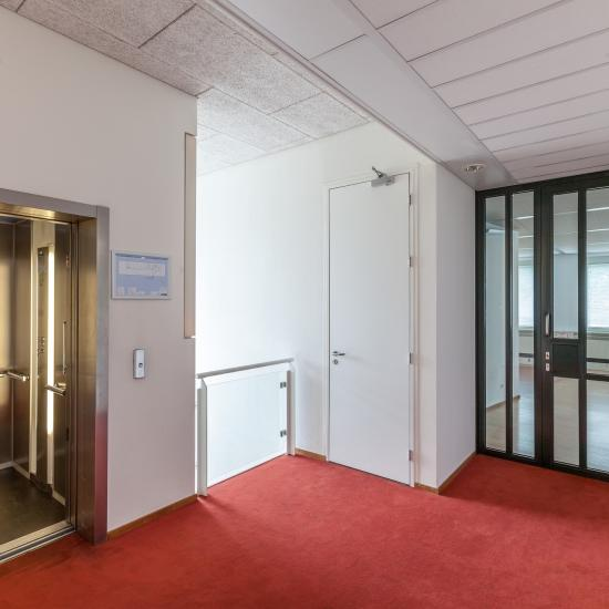 hallway office room red carpet doors elevator