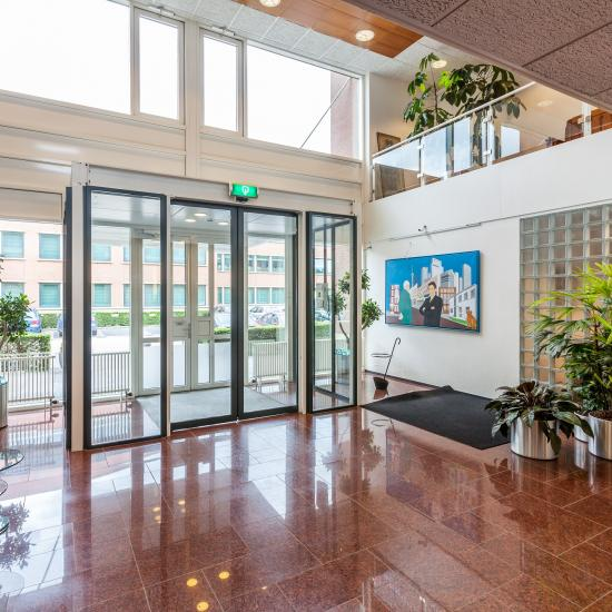 entrance office building green plants painting