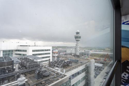 Uitzicht op het vliegveld kantoorruimte Amsterdam Schiphol Vliegveld