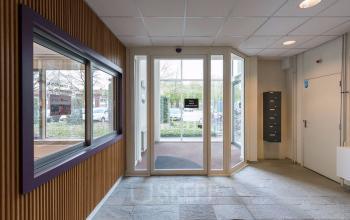 entrance office building tilburg wooden wall