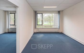 office building tilburg blue carpet