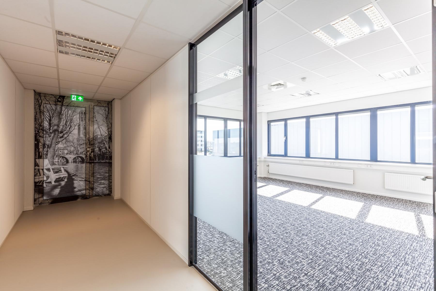 office space glass doors hallway carpet