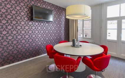 round table with red chairs light television