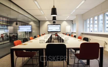 meeting room table chairs screen lights