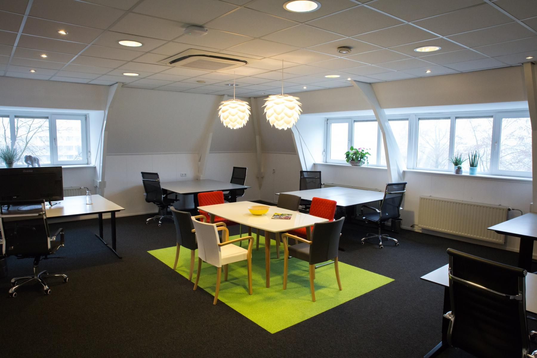 office room tables and chairs green carpet