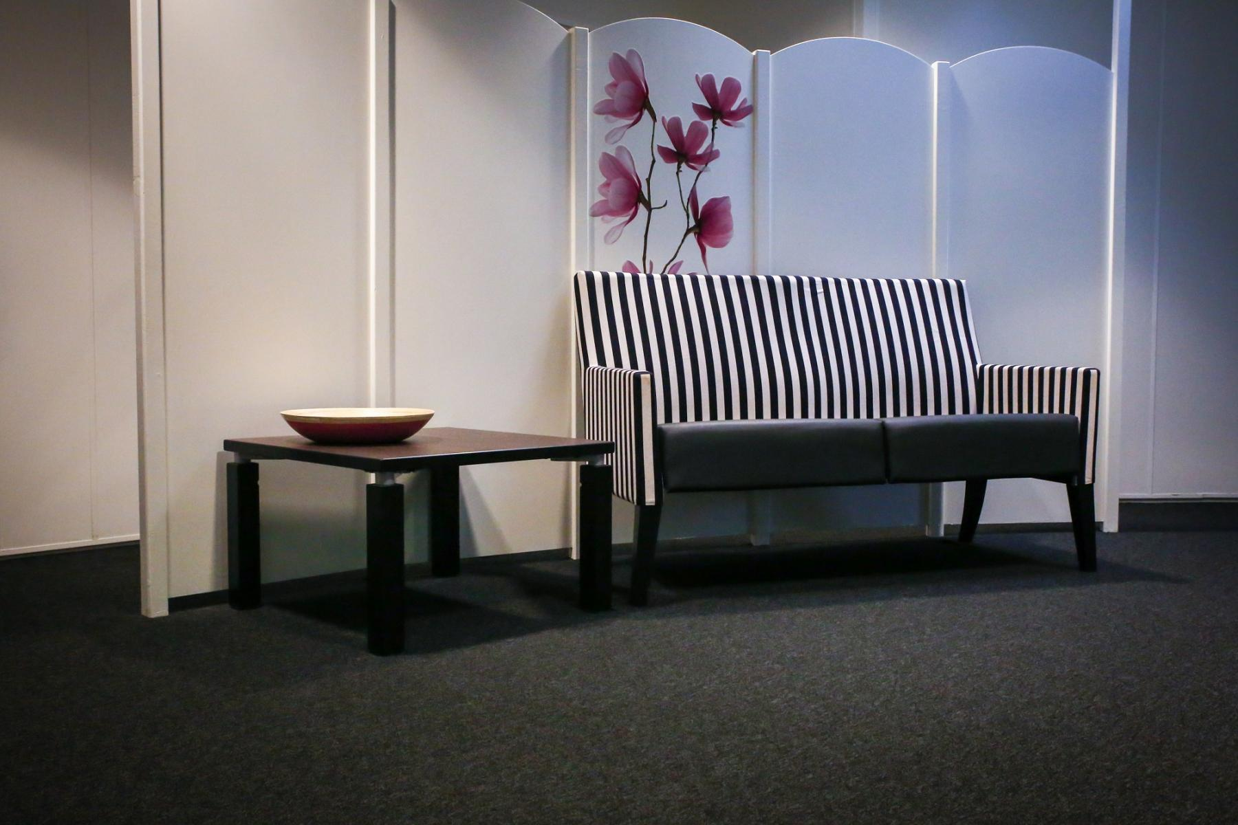 couch white striped flowers table