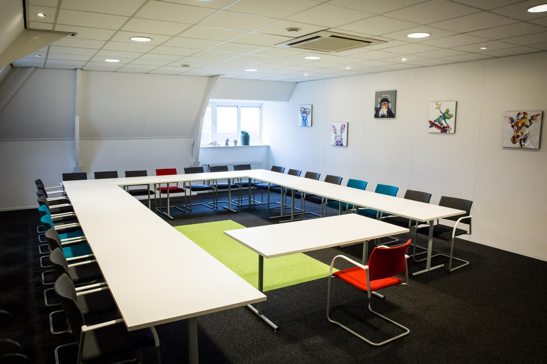big meeting room for a lot of people colorful chairs