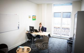 small office room one person light desk whiteboard