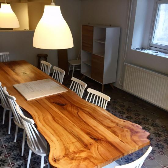 Long wooden table in meeting room