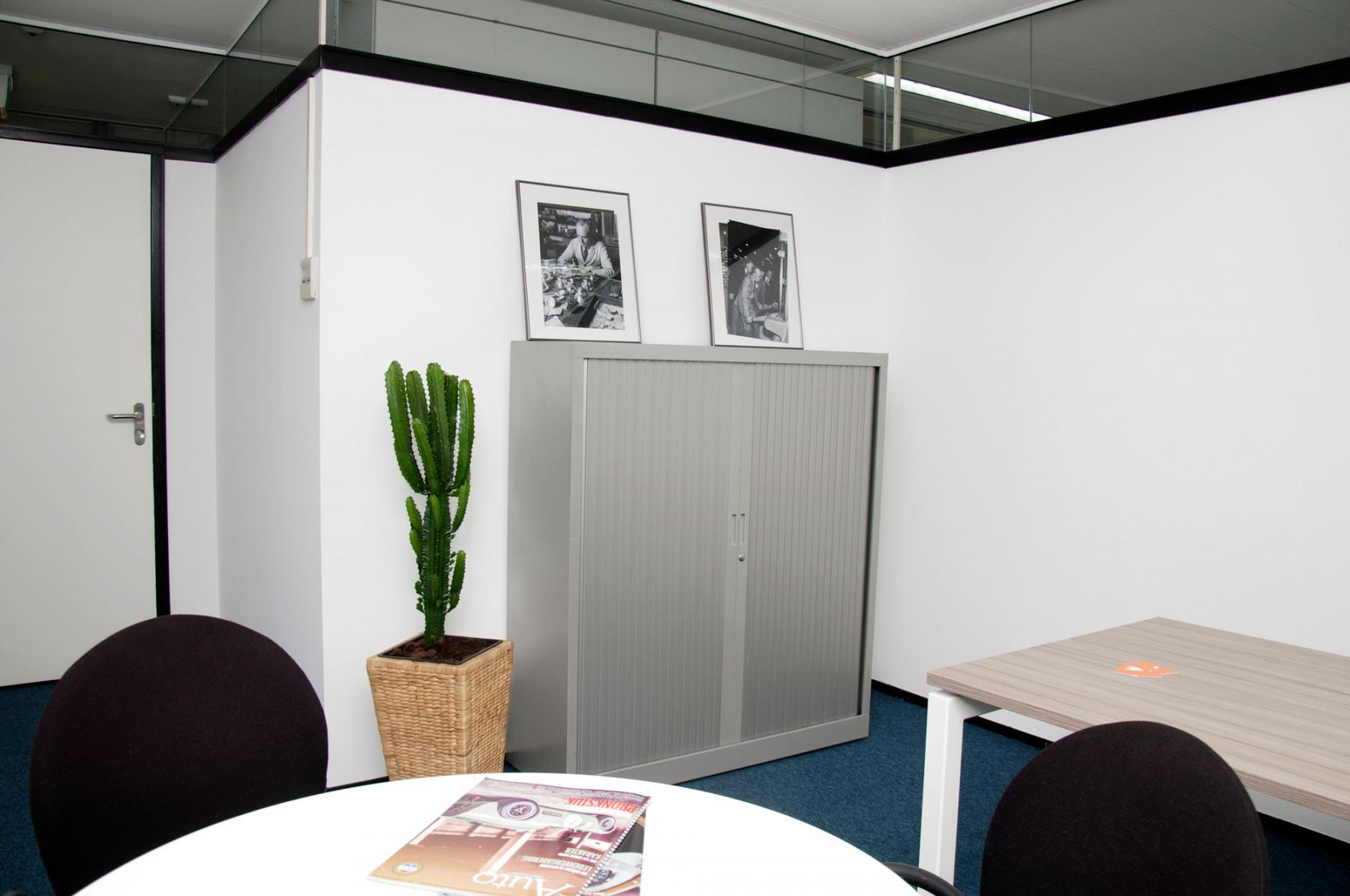 Office space with a closet against the wall