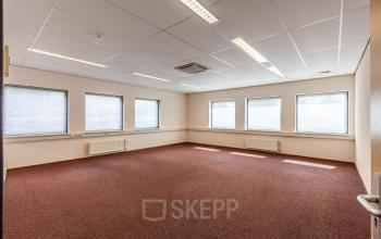 office space for rent red carpet windows bright room