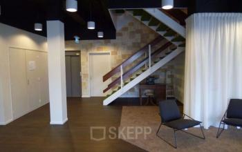 Office space with stairs in hallway