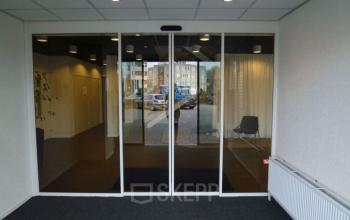 Office building with doors of glass